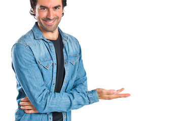 Man presenting something over isolated white background