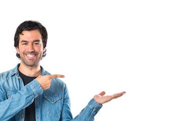 Man holding something over white background