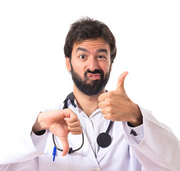 Doctor making a good-bad sign over white background