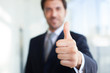 Leinwanddruck Bild - Businessman giving thumbs up