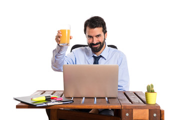 Businessman in his office drinking orange juice