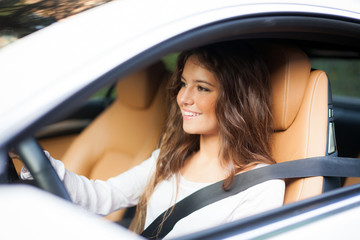 Smiling woman driving her car