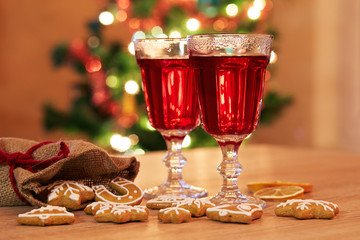 Two glasses of mulled wine with gingerbread and spices