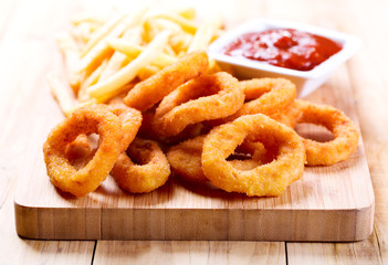 onion rings and fried potato with ketchup