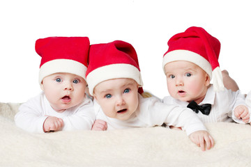 cute babies with santa hats