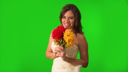Happy and beautiful bride holding flowers. Shot on Green Screen.