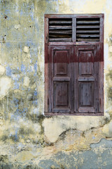 old authentic window and wall in George Town, Malaysia