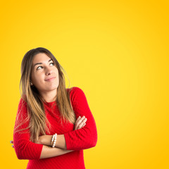 Young happy girl over yellow background