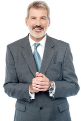 Businessman posing with clasped hands