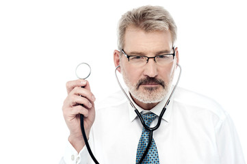 Senior doctor holding a stethoscope