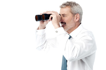 Male executive with binocular