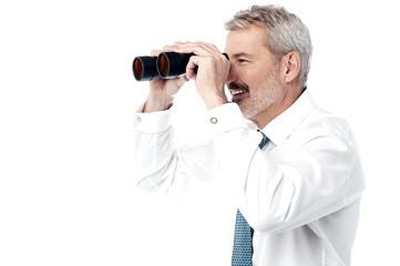 Male executive with binocular
