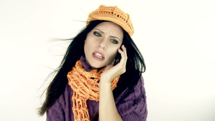 Woman angry on the phone in studio isolated