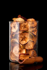 dried fruits apples on black background