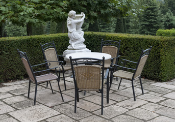 italian garden with chairs and table