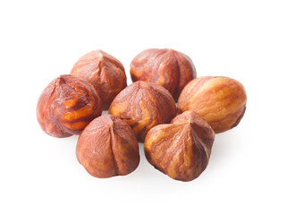Group peeled hazelnuts isolated on white background.