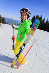 Ski, winter fun - lovely skier enjoying ski vacation