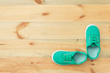 Green shoes on a wooden floor.