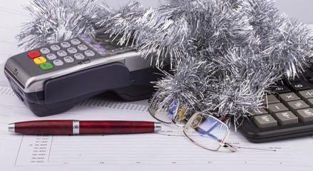 Business Christmas of payment terminal, calculator, pen, tinsel