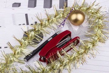 Business Christmas of a ball, stapler, pen, pencil, tinsel