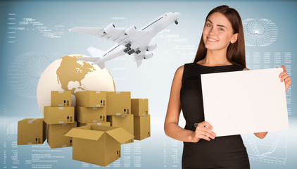 Businesswoman hold paper sheet. Earth with heap brown cardboard