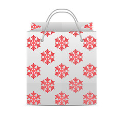 Shopping bag with a pattern of snowflakes isolated on a white ba