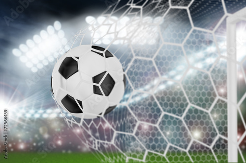 soccer ball in goal net - 72566459