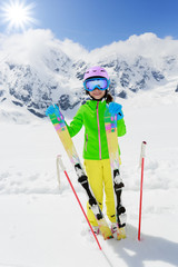 Ski, winter fun - lovely girl enjoying ski vacation