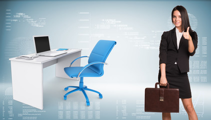 Businesswoman showing thumb-up. Office table with chair and