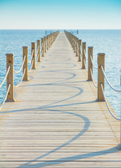 Pier in Heavenly Blue Place © alma_sacra