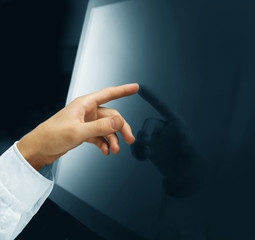 hand pushing touch screen