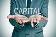 capital in a businessman hands