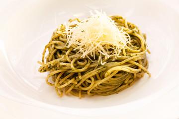 spaghetti mixed with pesto