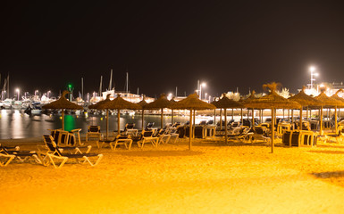 Plenty of sun loungers on the beach at night.