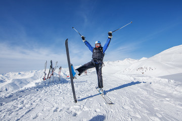 Skier is posing at camera