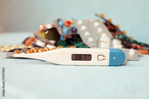 Poster Vitamin c tablet and pills stack with thermometer