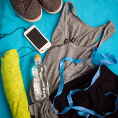 Sport clothes and water bottle. Fitness concept