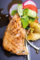 Roasted salmon fish fillet with assorted vegetables