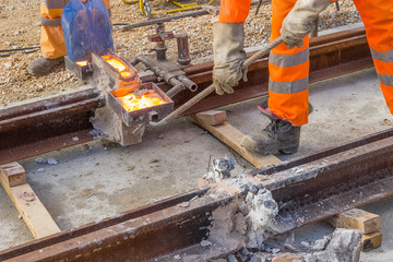 builders weld and joining segments of the rail