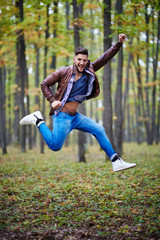 Young man jumping for joy