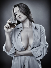 Busty woman drinking whiskey