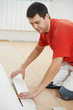 carpenter worker joining parket floor