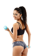 Dumbbells workout, young woman
