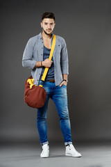 Young caucasian student with bag
