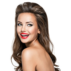 Beautiful laughing woman with brown wavy hair.