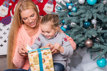 Mom and daughter preparing for Christmas