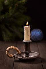 Candle on christmas decorations background