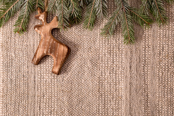 Christmas decoration with fir branch and wooden deer above
