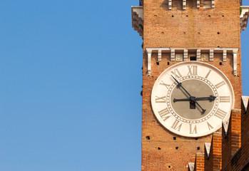 Closeup view of tower clock of Lamberti Tower at right side