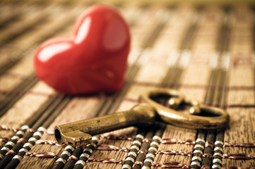 Key and heart with focus on the key